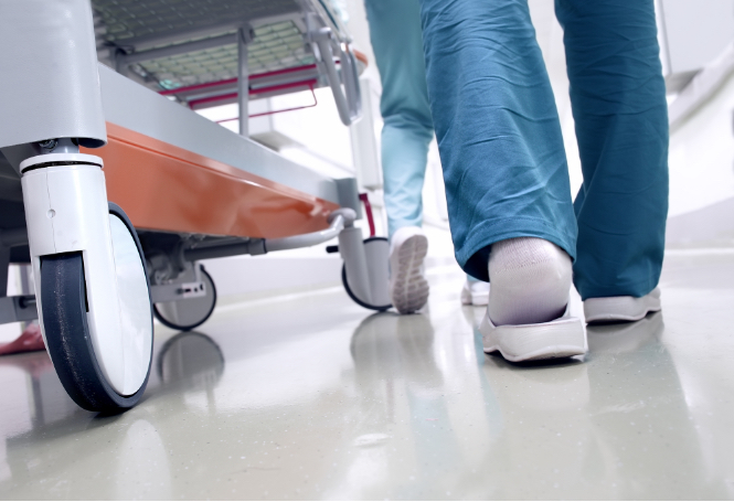 Medical staff walking on a white floor